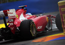 Fernando Alonso gets close to the barriers in his Ferrari