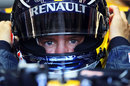 Sebastian Vettel clips on his HANS device
