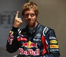 Sebastian Vettel celebrates pole position in his familiar style
