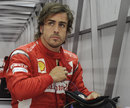 Fernando Alonso at the back of the Ferrari garage