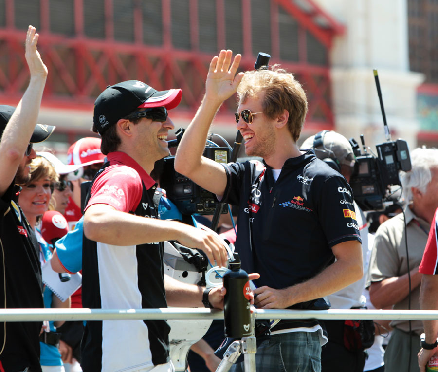 Sebastian Vettel waves to the crowd on the drivers' parade