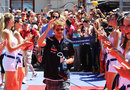Sebastian Vettel enjoys the attention of the grid girls