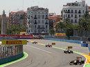 Sebastian Vettel leads Mark Webber into turn two