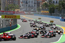 Lewis Hamilton and Jenson Button follow the Ferraris into turn two