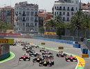 Sebastian Vettel leads into turn two at the start