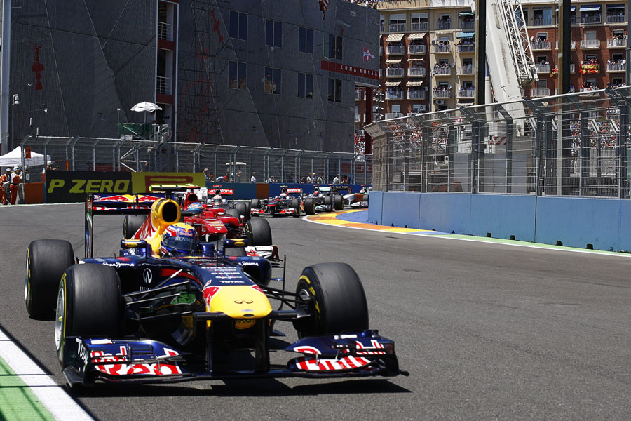 Mark Webber leads Fernando Alonso on lap one