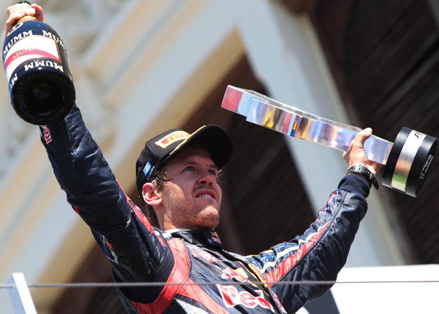 Sebastian Vettel celebrates his victory on the podium