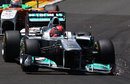 Sparks fly from Michael Schumacher's broken front wing