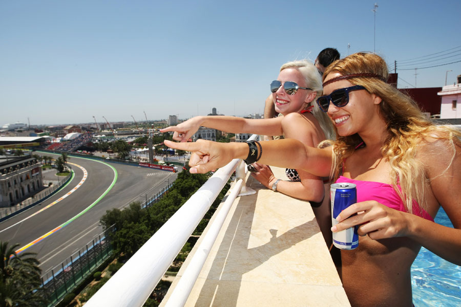 Girls watch the race from the Red Bull pool party