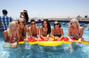 Girls pose for a photo at the Red Bull pool party