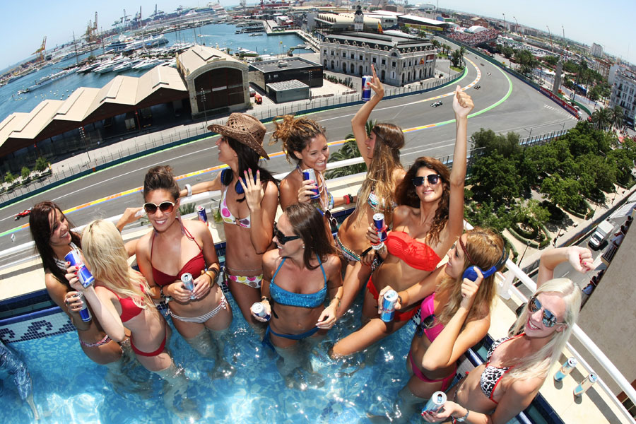 Girls celebrate the start of the race at the Red Bull pool party