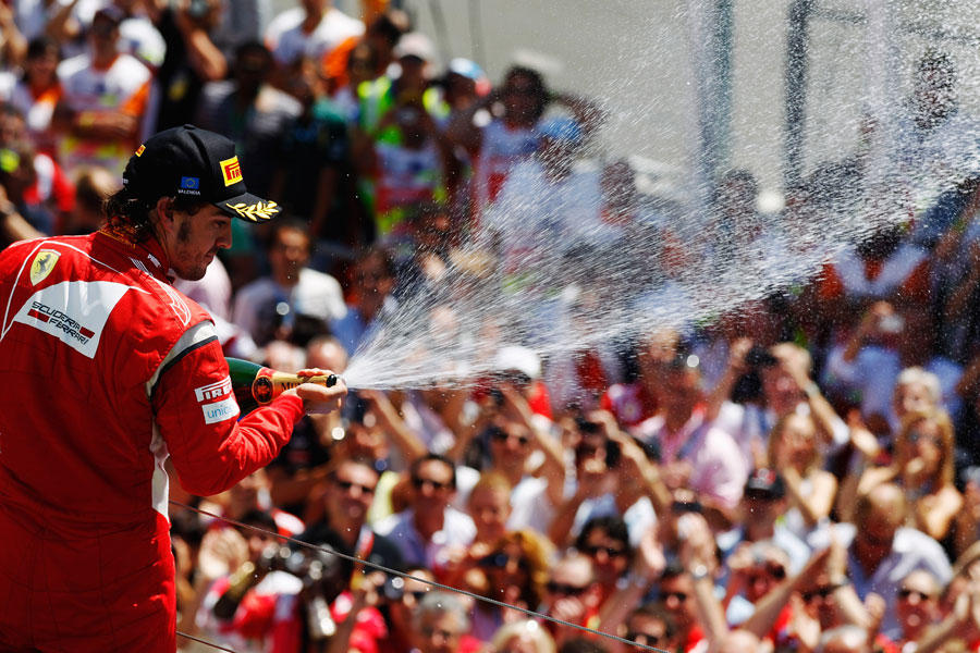 Fernando Alonso celebrates his second place in front of his home fans
