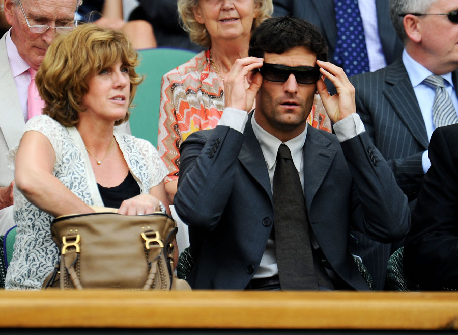 Mark Webber takes in the action at Wimbledon on Monday