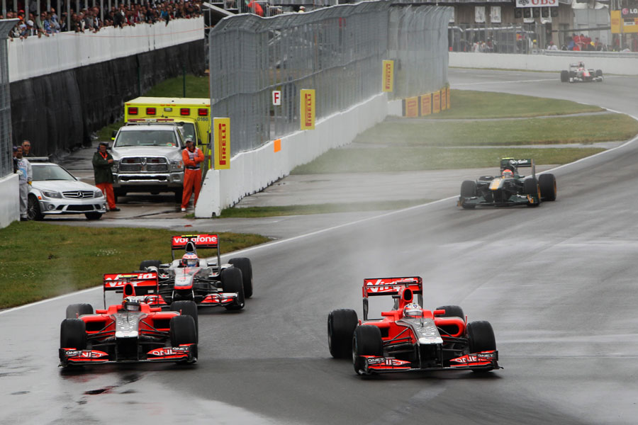 Jerome d'Ambrosio and Timo Glock battle as Jenson Button looks for a way through