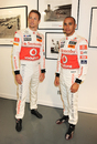 Lewis Hamilton and Jenson Button attend the launch of the 'Driven To Do Better' British Grand Prix exhibition