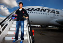 Mark Webber poses for a photo on the steps of an Airbus A380 after an announcement that he will train to become a pilot with the help of Qantas
