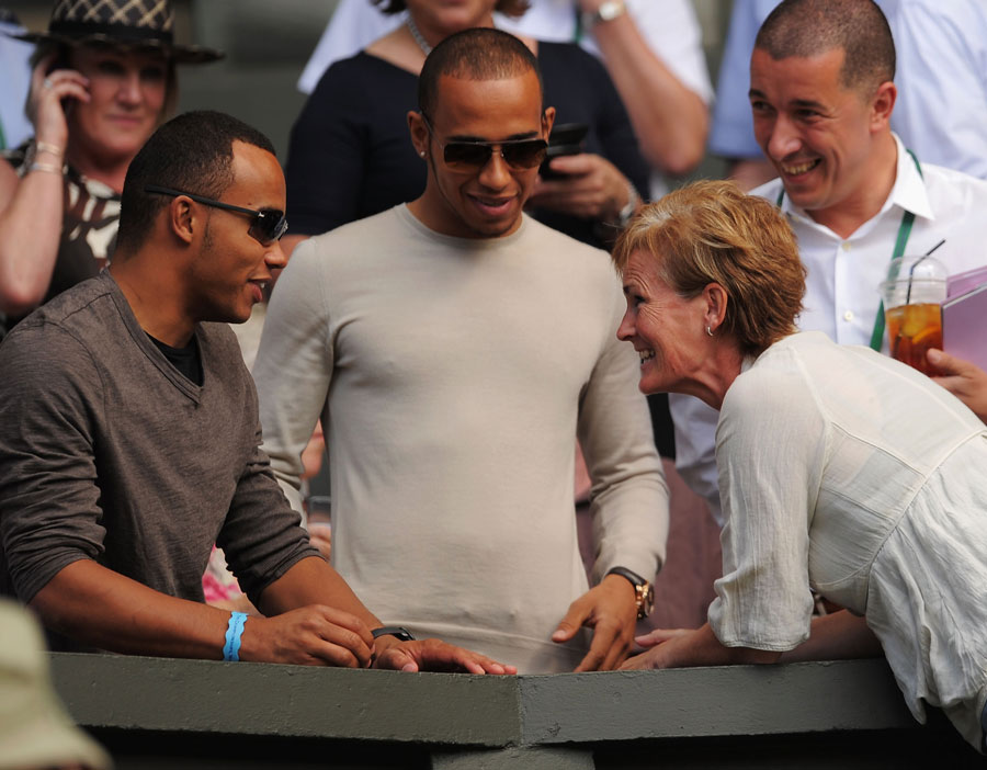Lewis Hamilton and brother Nic meet Andy Murray's mother Judy on Centre Court at Wimbledon