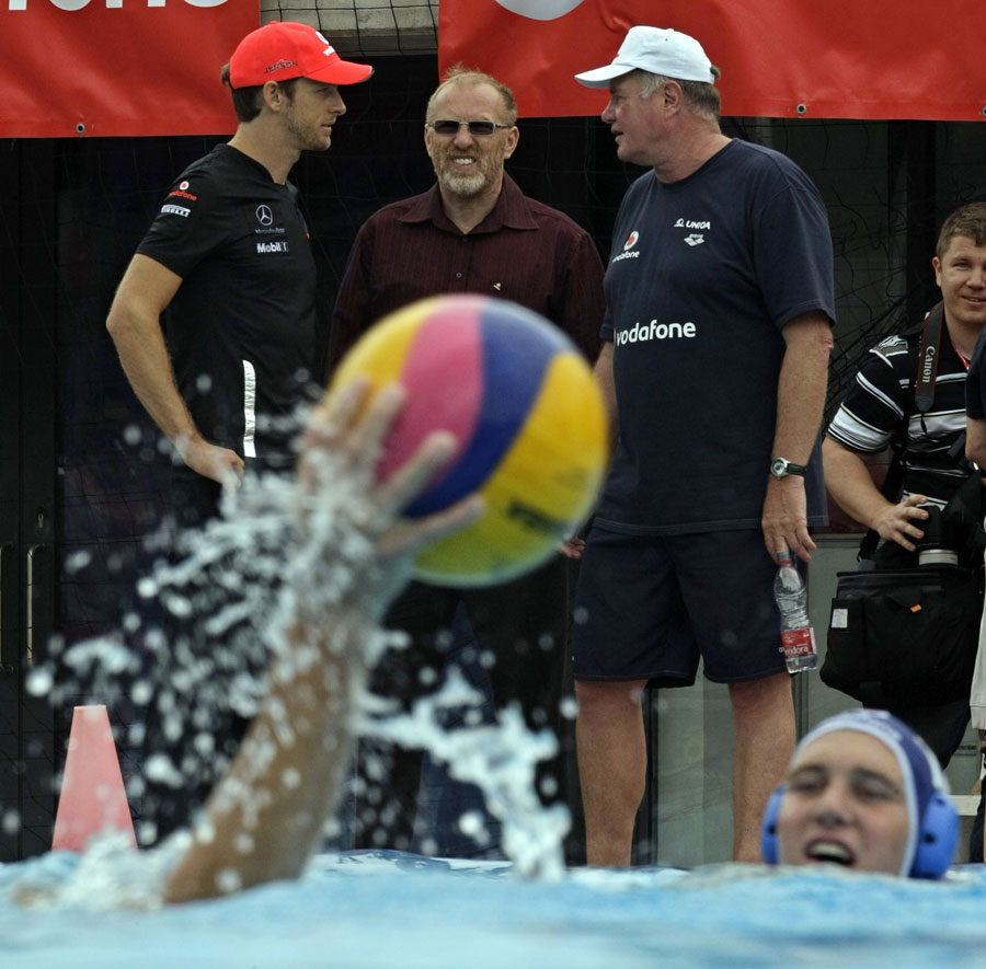 Jenson Button chats to the coach of the Hungarian national waterpolo team