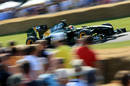 Karun Chandhok takes the Lotus T127 up the hill at Goodwood