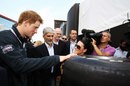 Prince Harry learns about the new hard tyre alongside Damon Hill