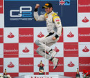 Roman Grosjean celebrates on the podium on the podium at Silverstone