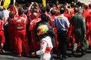 Lewis Hamilton walks back past the Ferrari celebrations