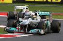 Nico Rosberg heads Sergio Perez