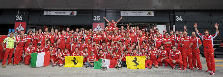 Fernando Alonso and his team celebrate their first win of the season