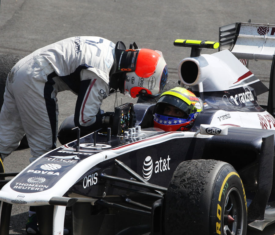 Rubens Barrichello talks to Williams team-mate Pastor Maldonado after the race