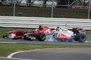 Jenson Button locks up as he passes Felipe Massa