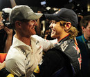 Michael Schumacher and Sebastian Vettel embrace