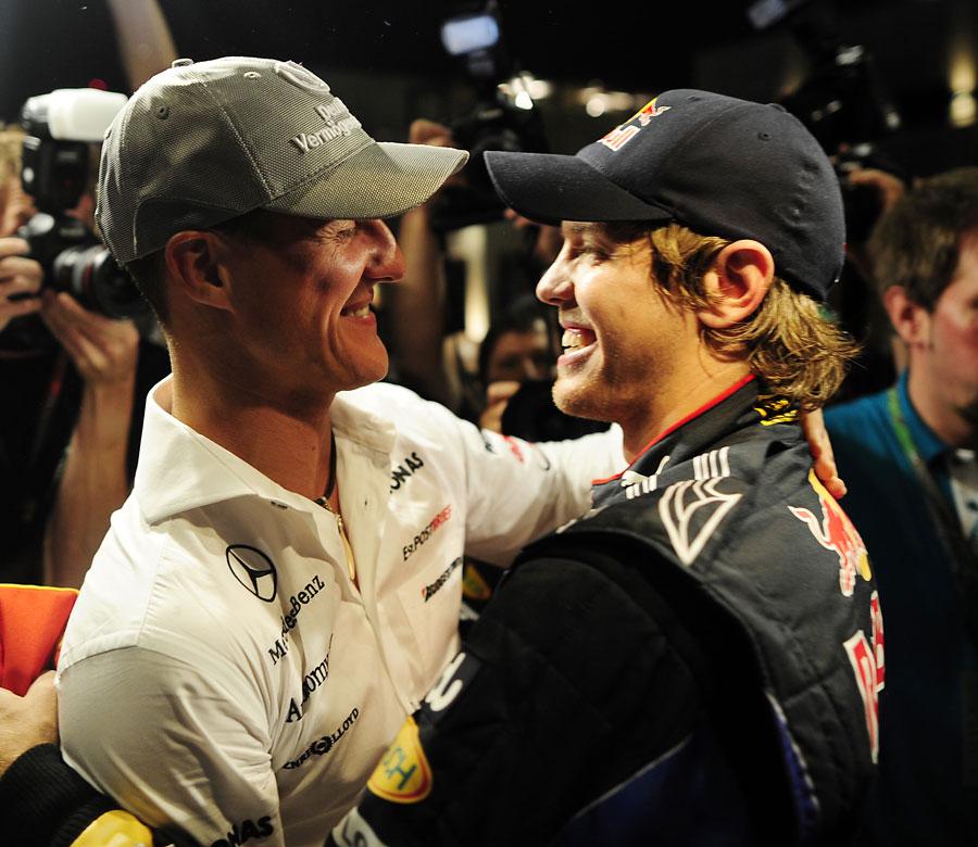 Michael Schumacher and Sebastian Vettel embrace