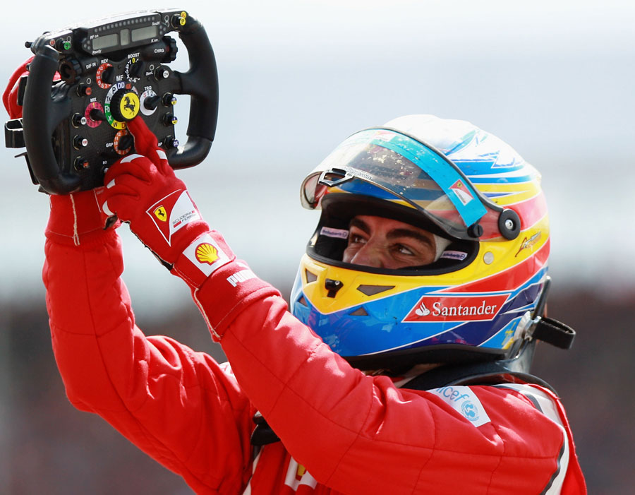 Fernando Alonso celebrates victory at Silverstone