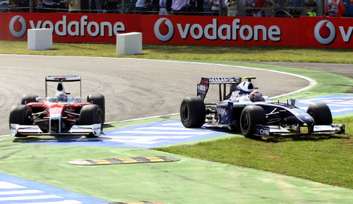 Kazuki Nakajima takes to the grass after tangling with Jarno Trulli