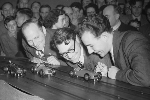 Reg Parnell, Bob Gerard and Stirling Moss at a slot car race