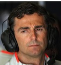 McLaren's third driver Pedro De la Rosa keeps an eye on the action