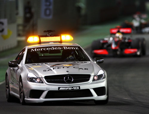 Lewis Hamilton held onto his lead behind the safety car