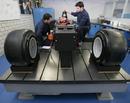 Kamui Kobayashi gets his seat fitted at Sauber