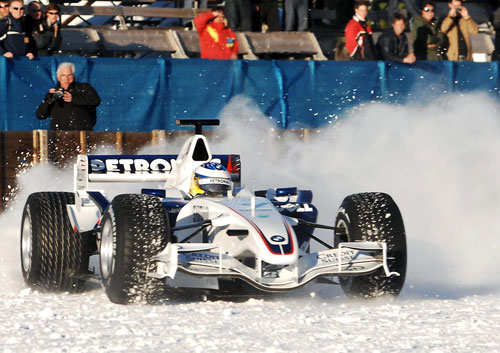 Nick Heidfeld shows off his skills on a frozen lake in Switzerland