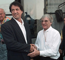 Bernie Ecclestone and Sylvester Stallone talk in the paddock