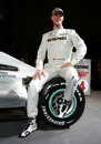 Michael Schumacher poses with the new Mercedes F1 car