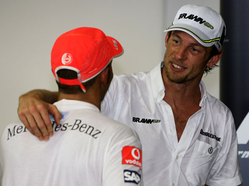 Lewis Hamiton congratulates Jenson Button on his title