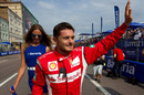 Giancarlo Fisichella waves to fans at the 'Moscow City Racing' show