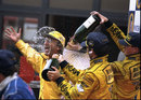Eddie Jordan celbrates his team's first victory with Damon Hill and Ralf Schumacher