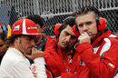 Fernando Alonso, his race engineer Andrea Stella and Ferrari technical director Pat Fry on the grid