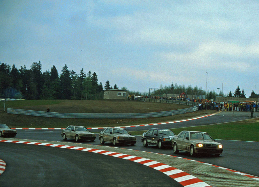 Niki Lauda leads a pack of cars during a celebrity race at the Nurburgring