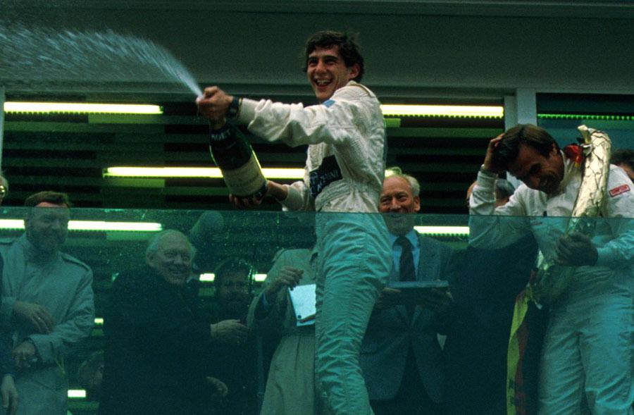 Ayrton Senna celebrates victory at a celebrity race at the Nurburgring