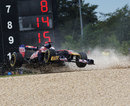 Sebastien Buemi's Toro Rosso gets launched into the air