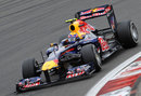 Mark Webber aims for an apex on his way to pole position