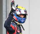 Mark Webber waves to the crowd after taking pole
